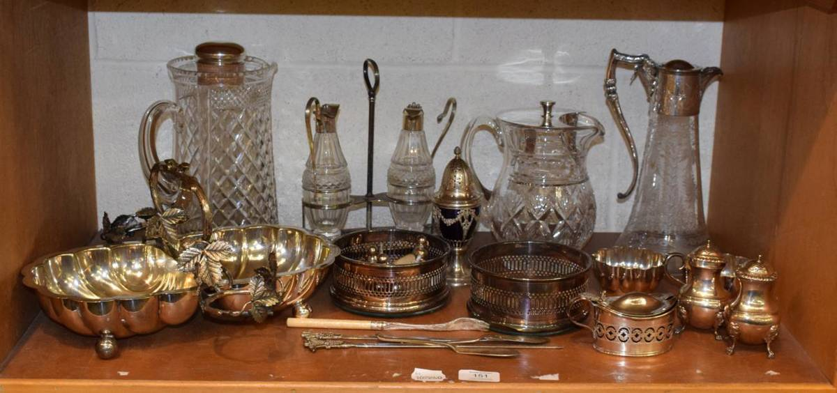 Lot 151 - A small group of silver plated wares including claret jug, bottle coasters, twin bottle cruet,...