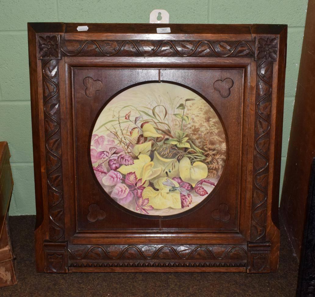 Lot 167 - A large Coalport floral platter in a heavy oak frame carved in the manner Pugin