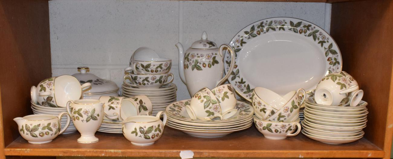 Lot 168 - A large service of Wedgewood strawberry hill patterned dinner wares (two shelves)