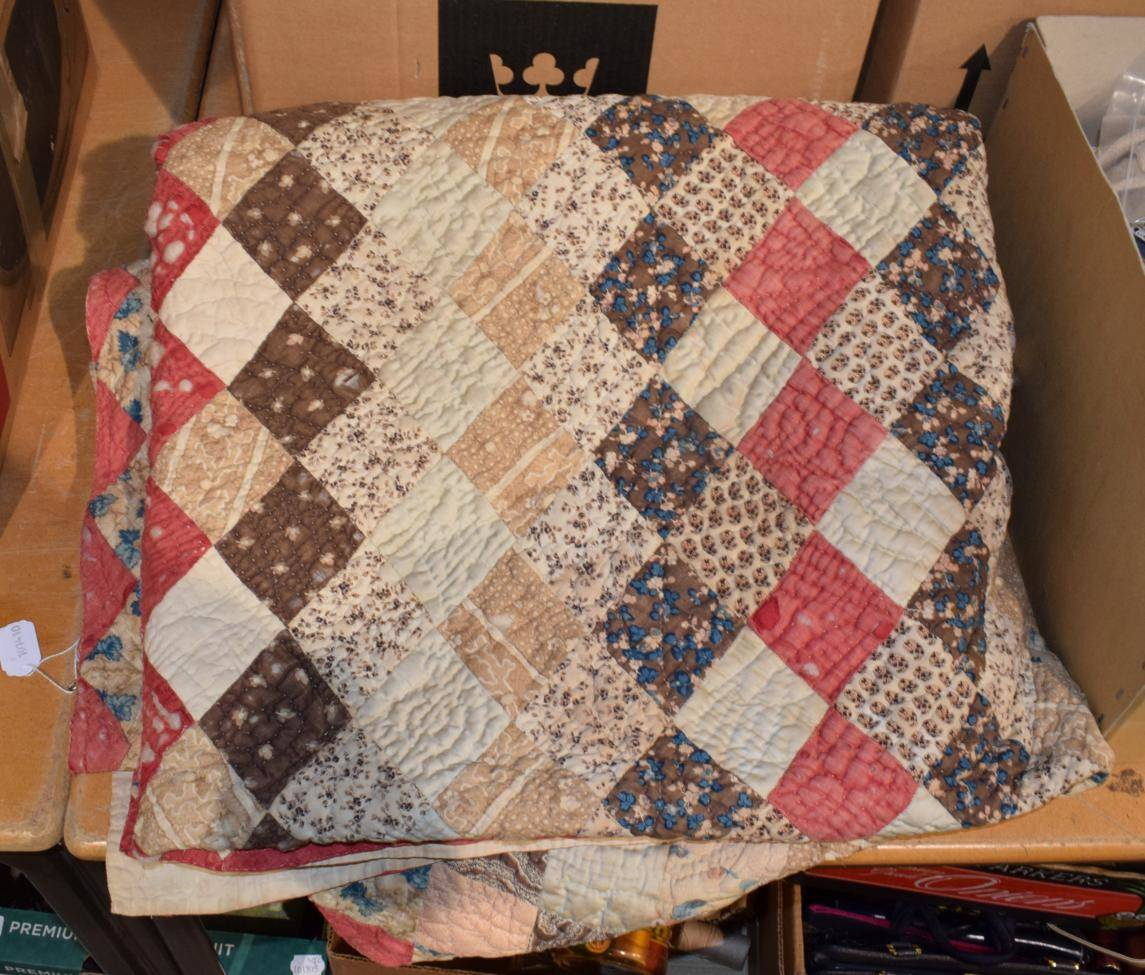 Lot 1009 - Large 19th century patchwork quilt decorated with mainly diamond patches in printed cottons,...