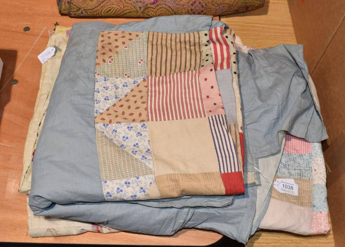 Lot 1038 - 19th Century patchwork cover with printed cotton coloured squares to the centre and blue fine...