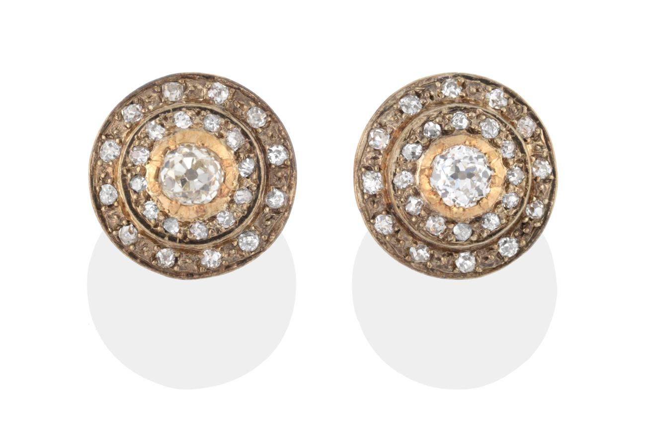 Lot 2004 - A Pair of Diamond Cluster Earrings, a central old cut diamond with two rows of old cut diamonds...