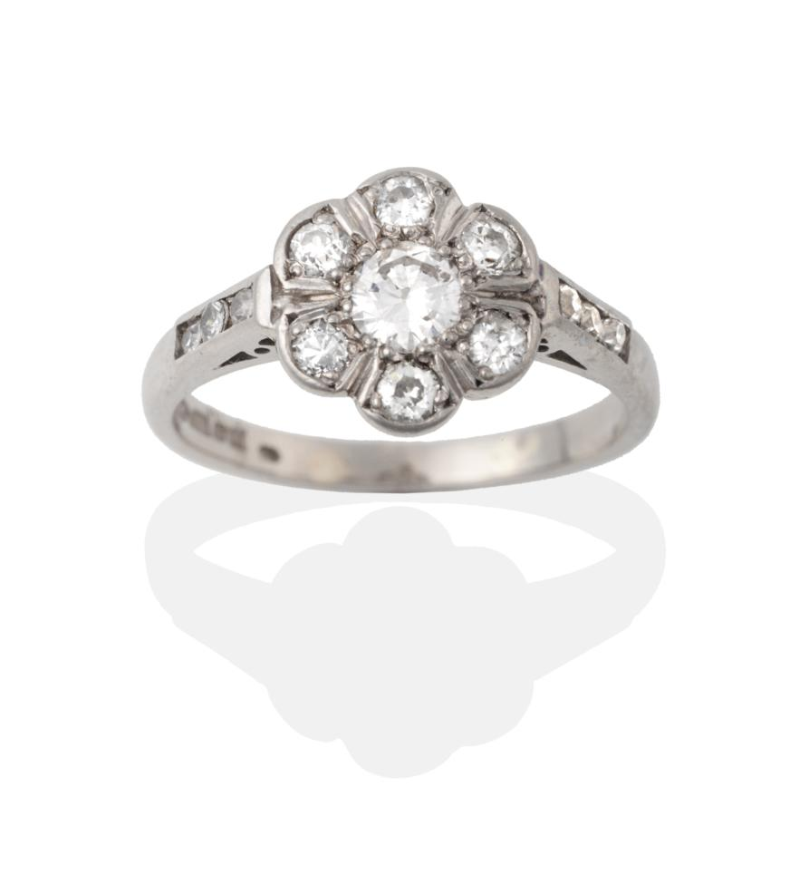 Lot 2040 - A Palladium Diamond Cluster Ring, the round brilliant cut diamonds in white claw settings, to...