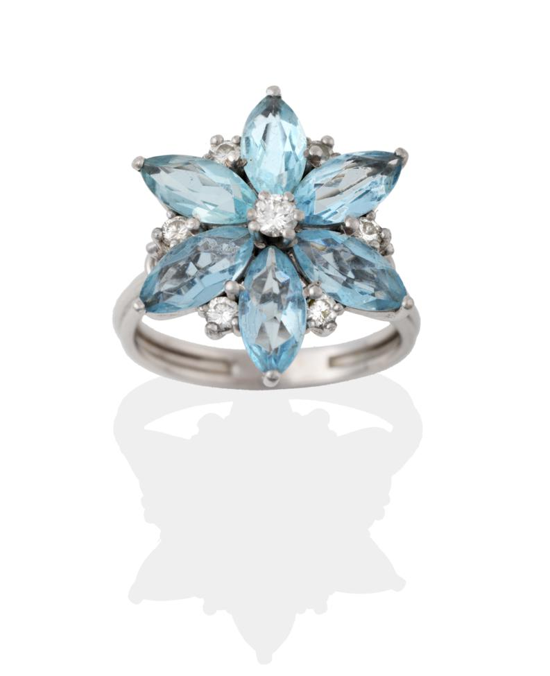 Lot 2041 - An Aquamarine and Diamond Cluster Ring, a round brilliant cut diamond centres a cluster of six...