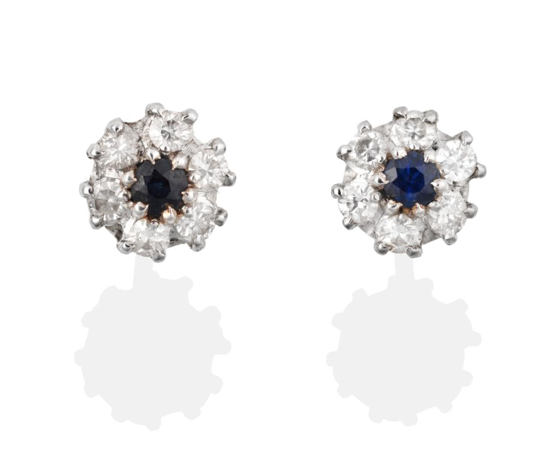 Lot 2044 - A Pair of 18 Carat White Gold Sapphire and Diamond Cluster Earrings, the round brilliant cut...