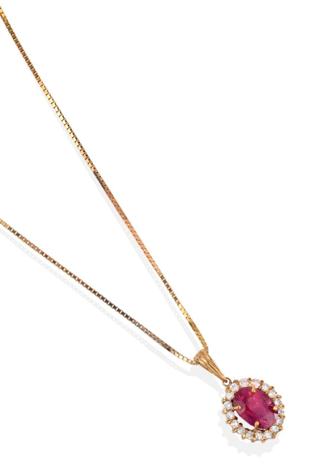 Lot 2055 - A Padparadscha Sapphire and Diamond Cluster Pendant on Chain, the oval cut sapphire within a border