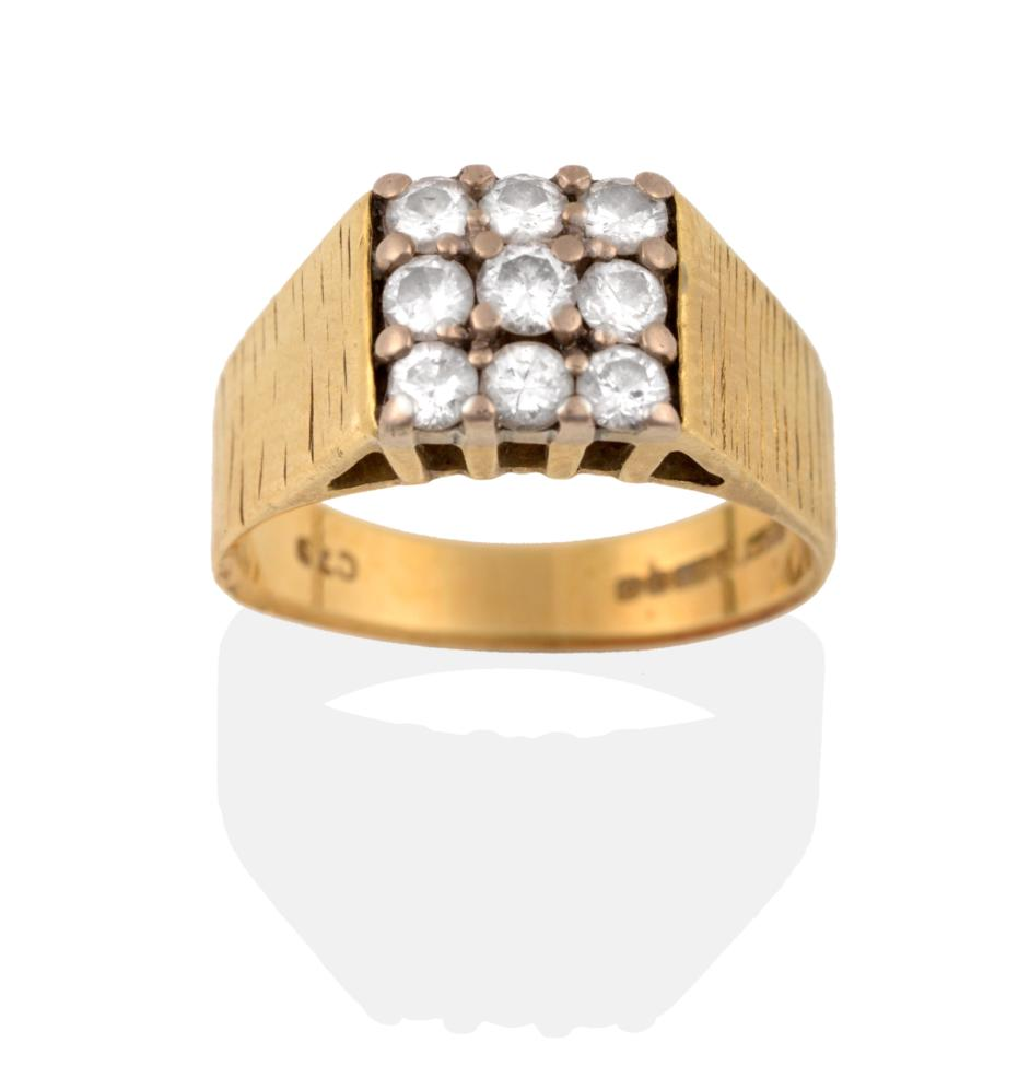 Lot 2056 - An 18 Carat Gold Diamond Cluster Ring, nine round brilliant cut diamonds in yellow claws to...