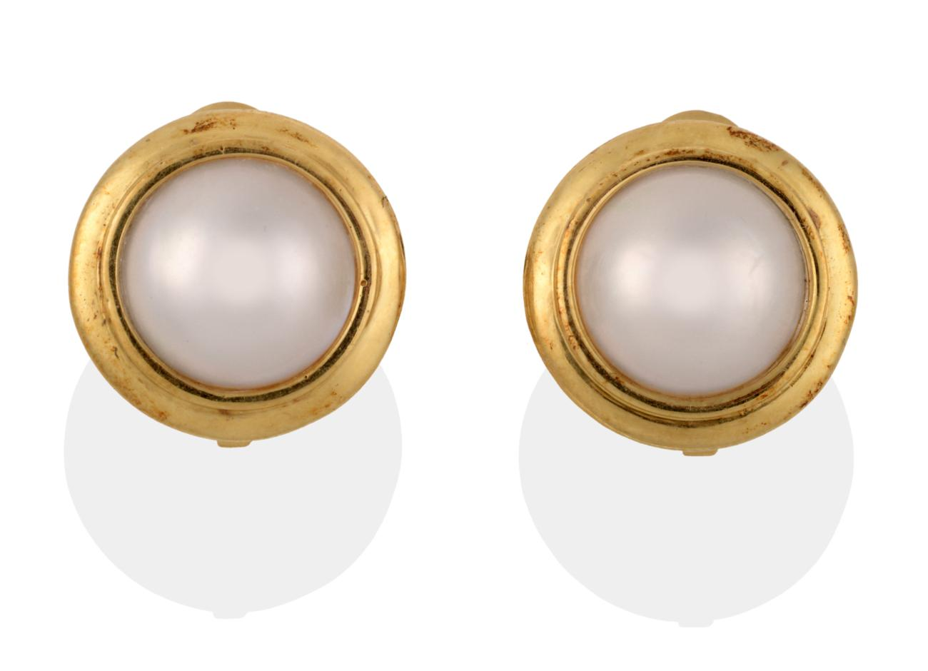 Lot 2065 - A Pair of Mabe Pearl Earrings, the large round mabe pearl in yellow collet mounts, diameter...