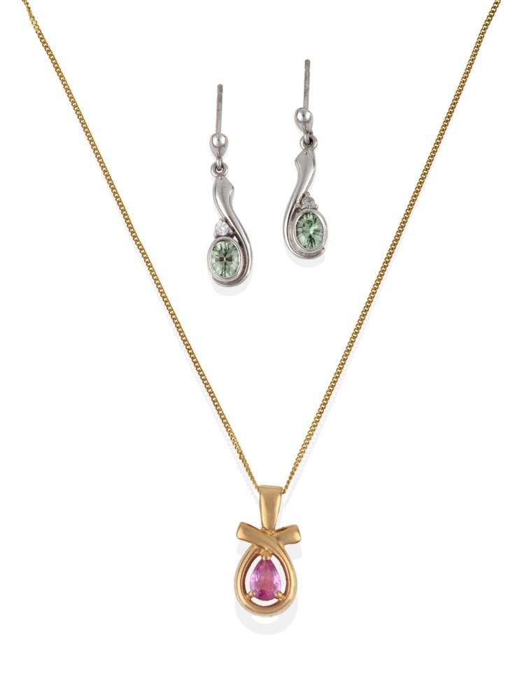 Lot 2067 - A 9 Carat Gold Pink Sapphire Pendant on 9 Carat Gold Chain, a pear cut pink sapphire in a...
