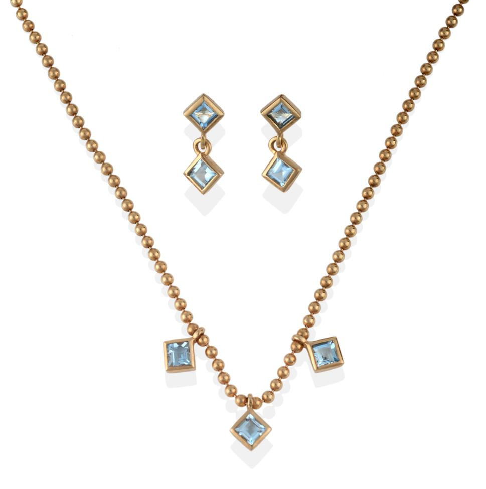 Lot 2069 - A 9 Carat Gold Aquamarine Necklace and Earring Set, the necklace of bead links with three...