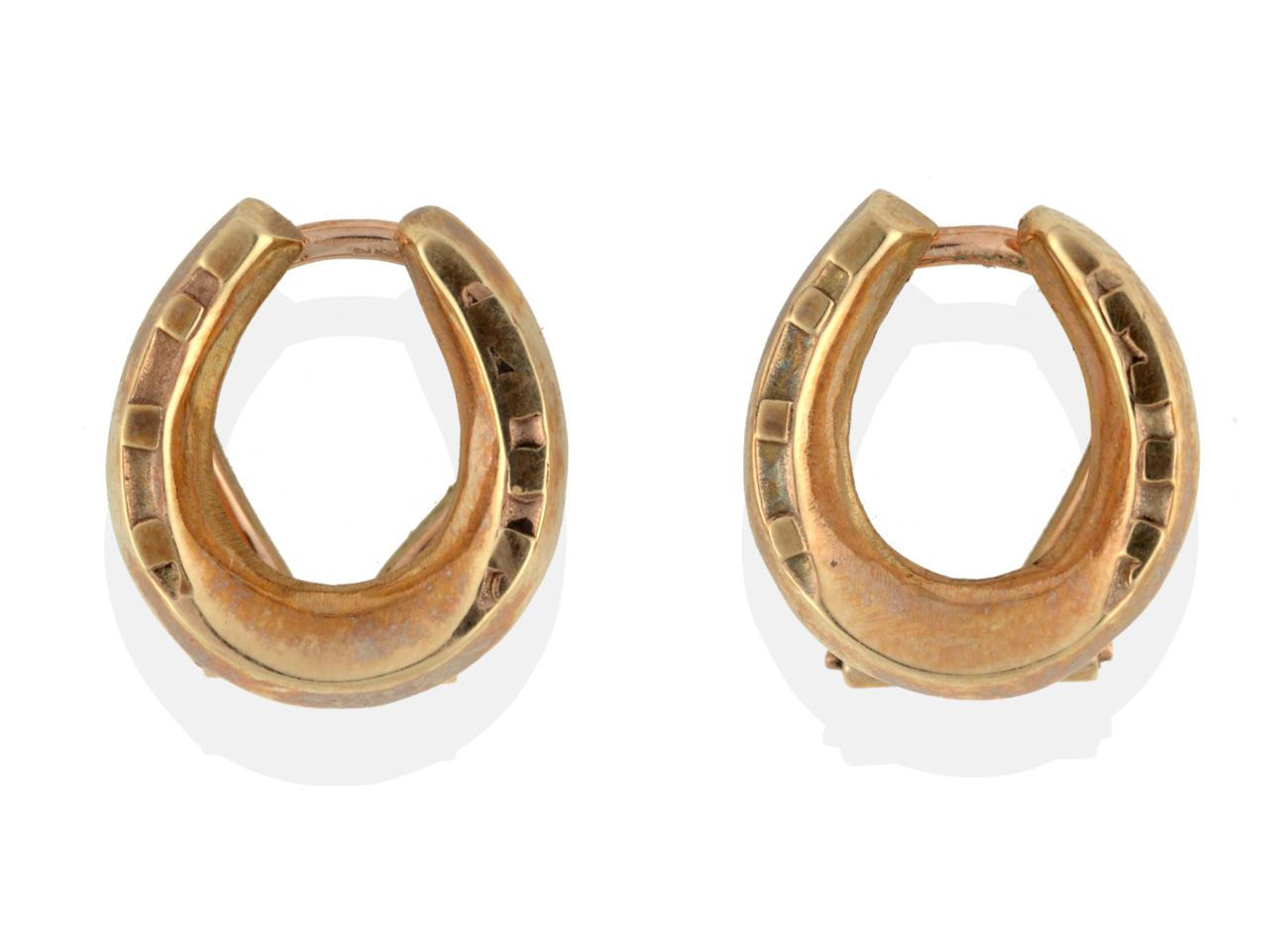 Lot 2071 - A Pair of 9 Carat Gold Horseshoe Earrings, with clip fittings, boxed by Boodle & Dunthorne see...