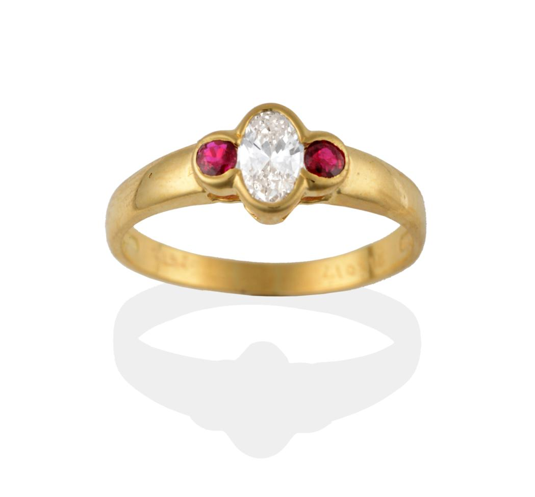 Lot 2072 - An 18 Carat Gold Diamond and Ruby Three Stone Ring, a central oval cut diamond flanked by a...