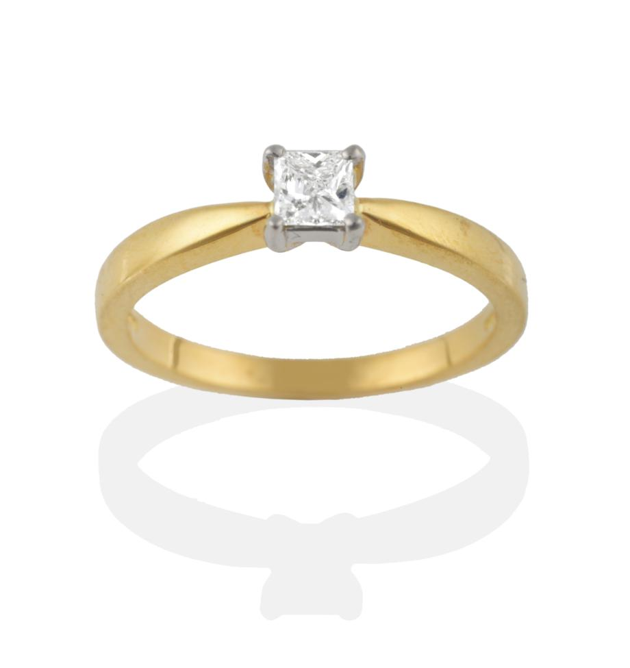 Lot 2083 - An 18 Carat Gold Diamond Solitaire Ring, the princess cut diamond in a white four claw setting on a