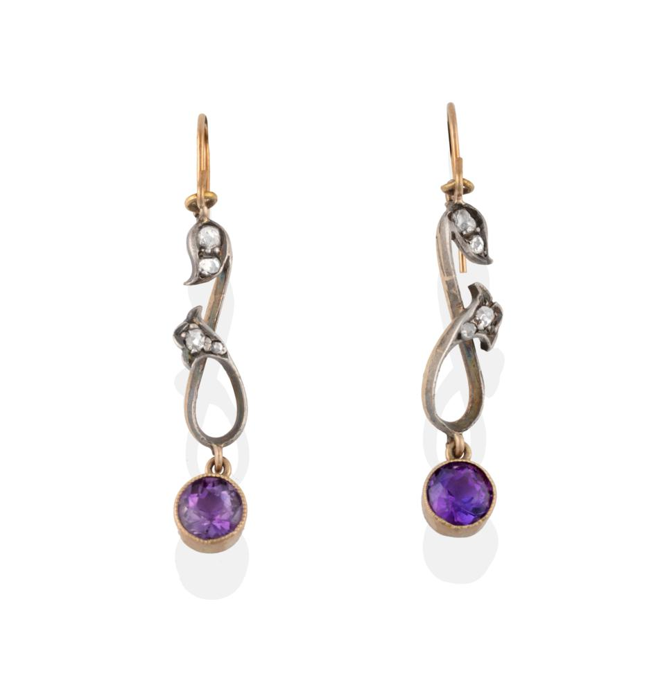 Lot 2094 - A Pair of Amethyst and Diamond Drop Earrings, two rose cut diamonds in white claw and rubbed...