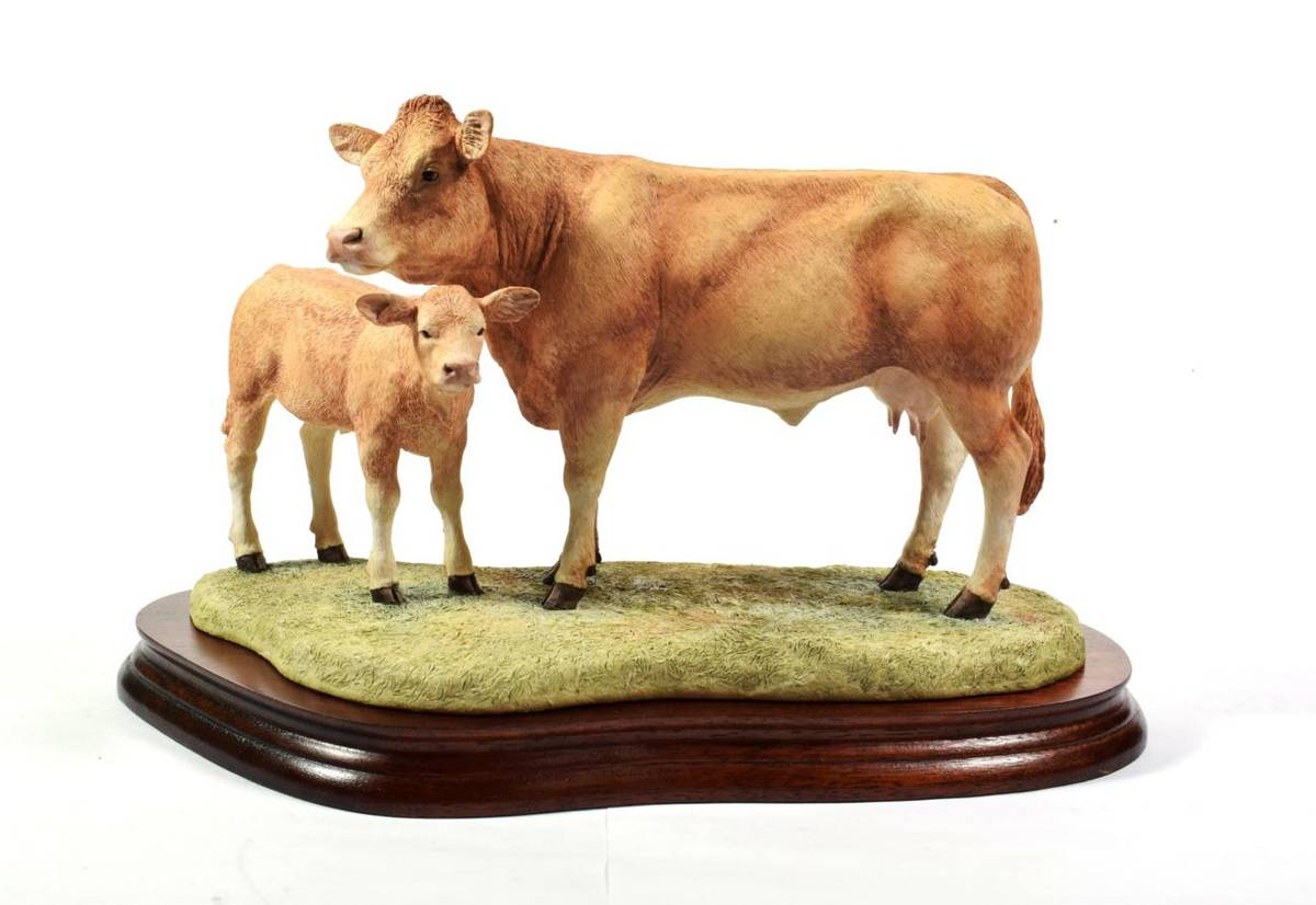 Lot 13 - Border Fine Arts 'Blonde D'Aquitaine Cow and Calf', model No. B0353 by Kirsty Armstrong,...