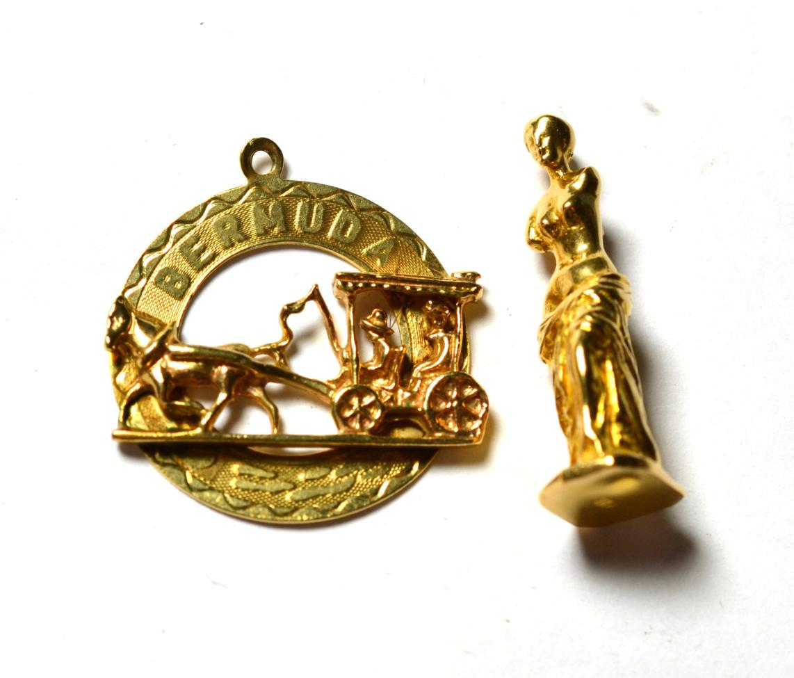 Lot 193 - A charm/pendant of the Venus de Milo stamped 'K18'; and a pendant depicting a horse and...