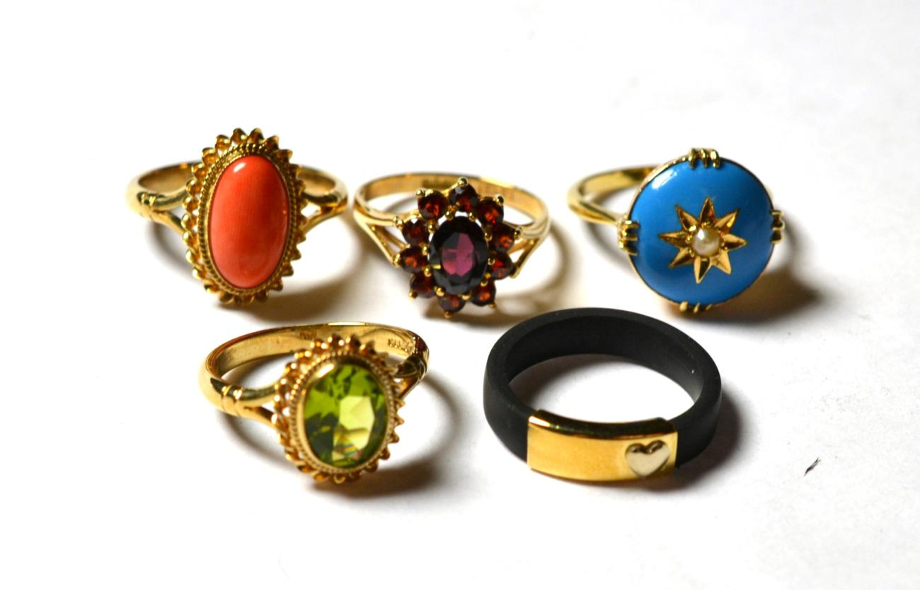 Lot 201 - A seed pearl and blue enamel ring, stamped '15CT', finger size L; a 9 carat gold garnet cluster...
