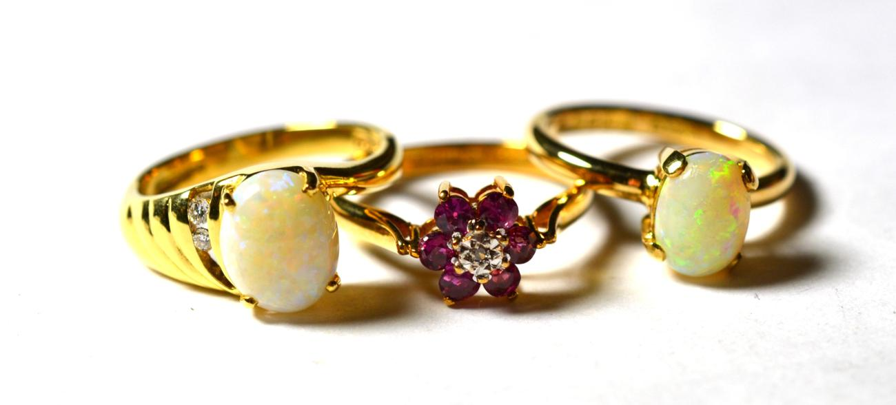 Lot 226 - A 9 carat gold ruby and diamond cluster ring, finger size O1/2; an 18 carat gold opal solitaire...