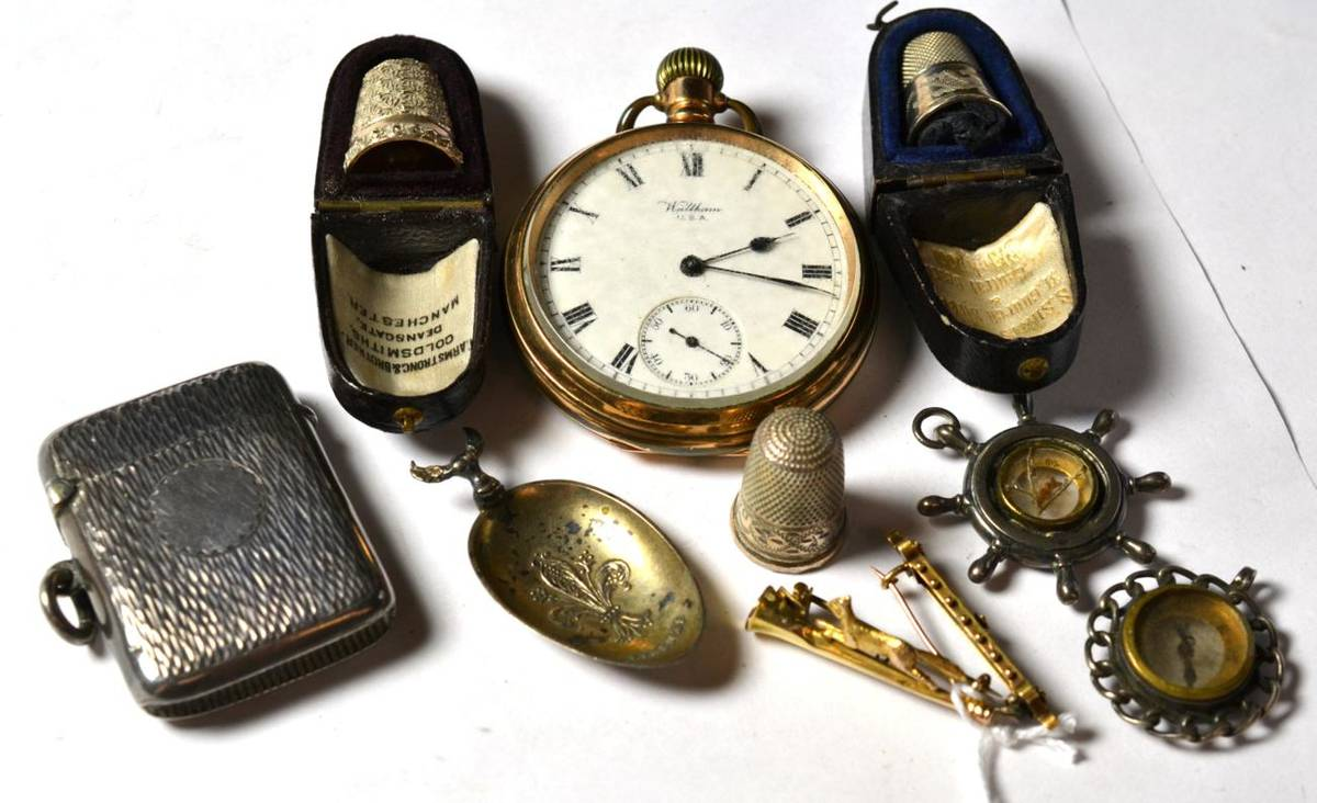Lot 231 - Three silver thimbles; a silver vesta case; a Waltham pocket watch; a running fox and hunting...