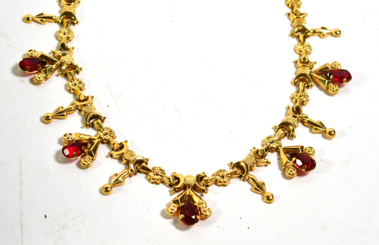 Lot 357 - A necklace stamped '750' set with red glass stones, length 46cm