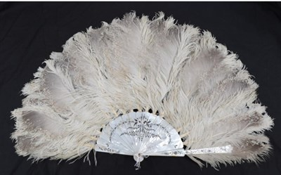 Lot 2033 - A Large Late 19th Century Mottled Ostrich Feather Fan, mounted on quite substantial white...