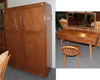 Lot 1000 - An Ercol Windsor Pattern Double Door Wardrobe, the interior with hanging space, 121cm by 53cm...