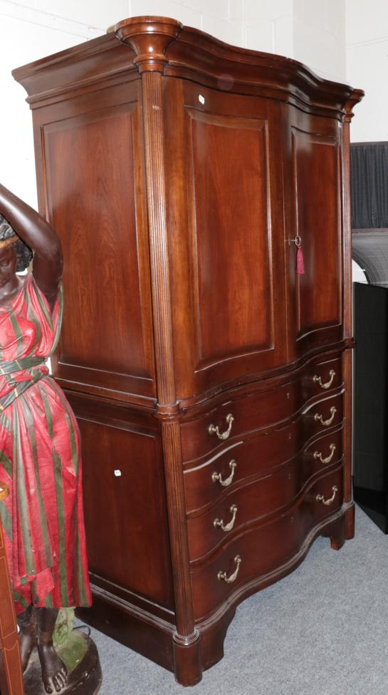 Lot 1005 - And So To Bed: An Eclectic Armoire, modern, of serpentine shaped form with two cupboard doors...