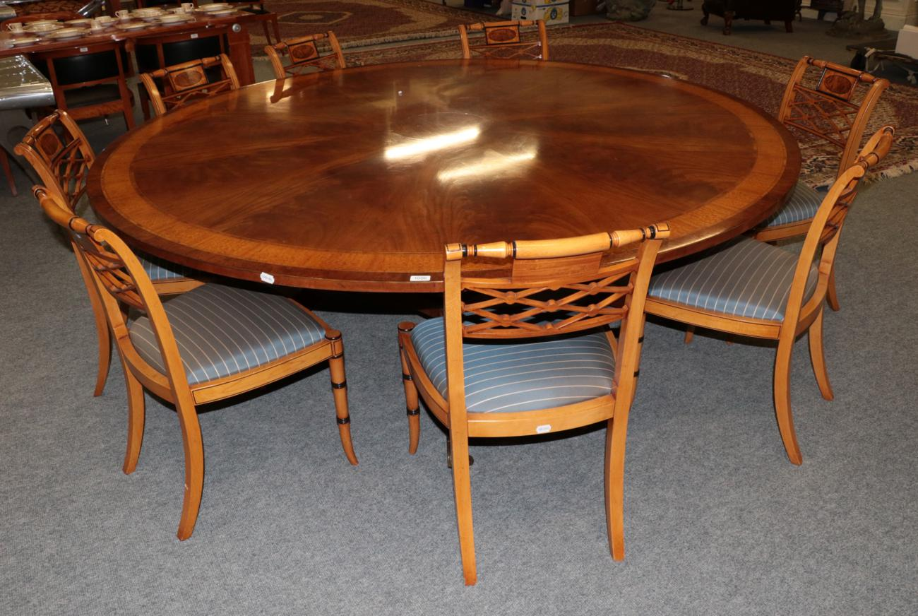 Lot 1006 - A Reproduction Mahogany Satinwood and Burr Wood Crossbanded Circular Dining Table, in the...