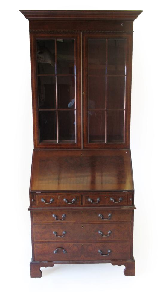 Lot 1009 - A Reproduction Burr Walnut and Feather Banded Bureau Bookcase, modern, the upper section with...