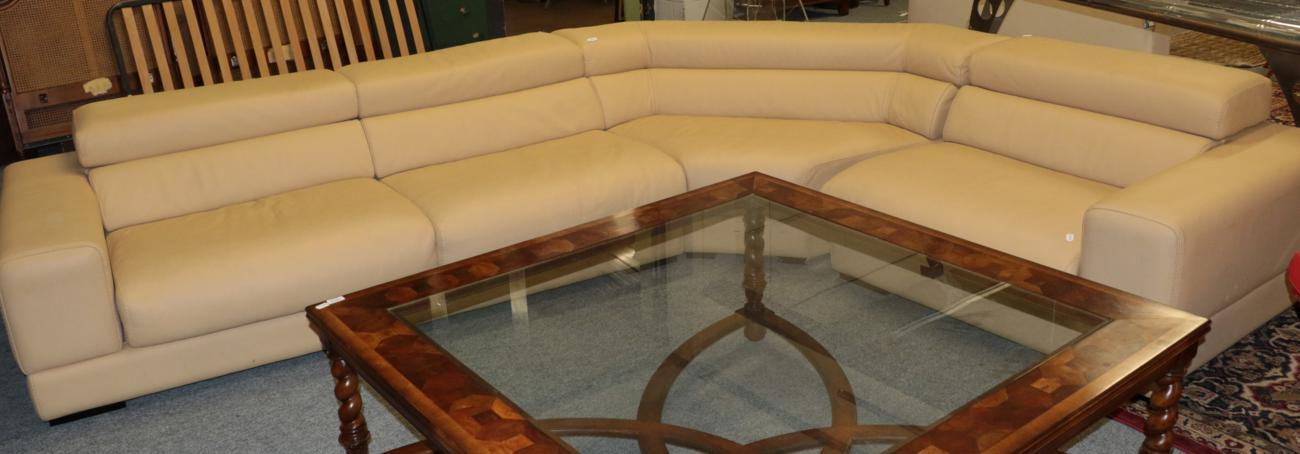 Lot 1011 - Roche Bobois: A Beige Leather Modular Sofa, modern, in three sections, with pivoting back...