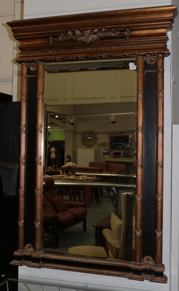 Lot 1026 - A Gilt Bevel Glass Mirror, the rectangular frame surrounded by reeded pilasters, the base with...