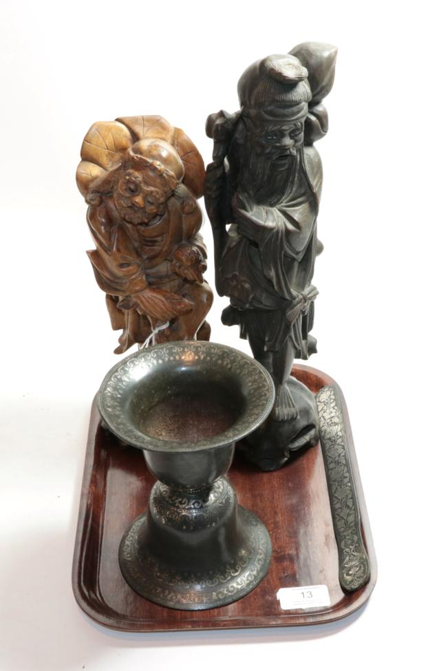 Lot 13 - A Chinese silver inlaid root wood carving, another Chinese carving of Lu Hai sporting with the...