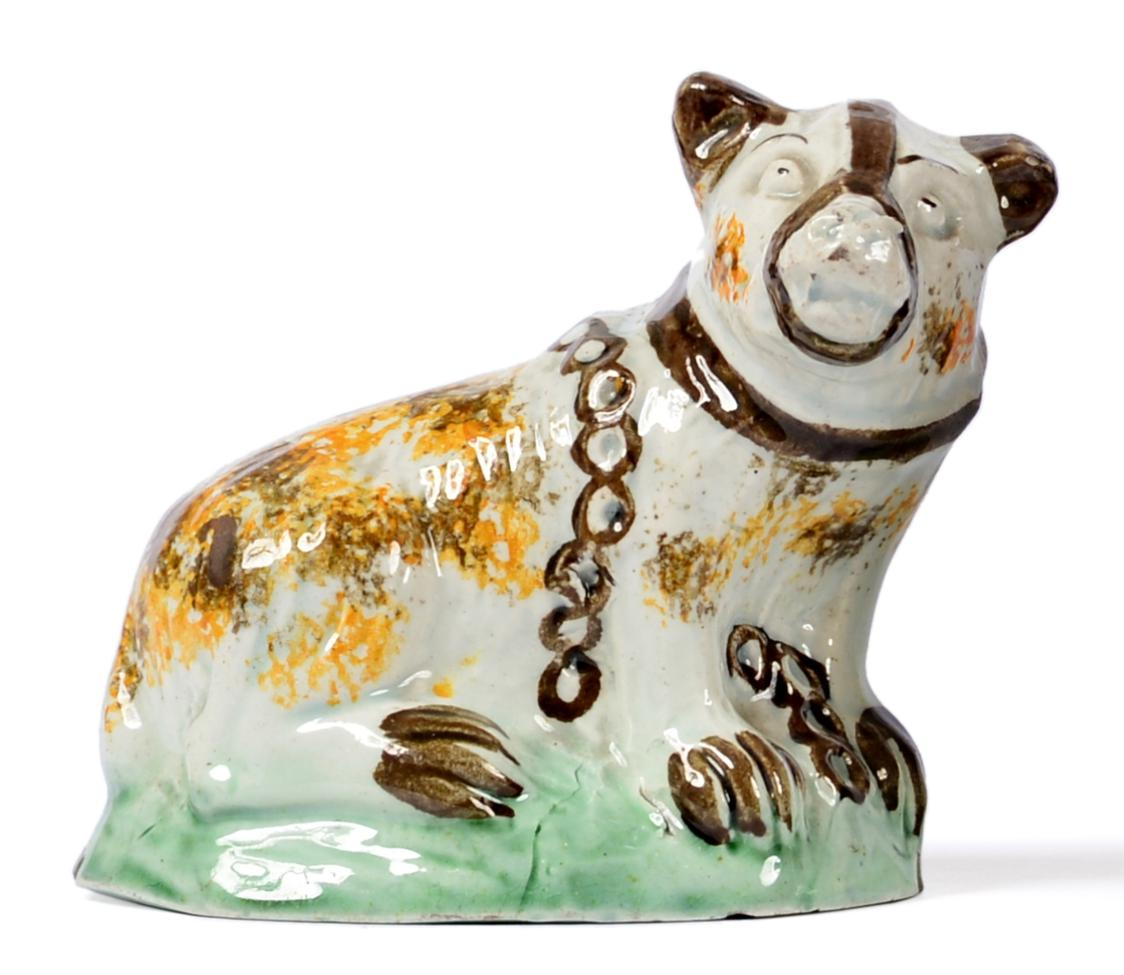 Lot 2 - A Pratt-Type Figure of a Bear, circa 1800, the seated animal with brown and ochre sponged markings