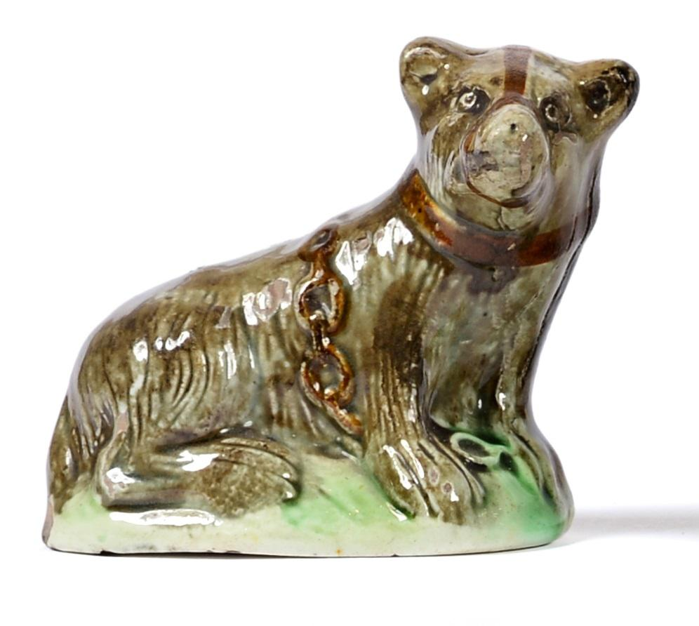 Lot 5 - A Creamware Model of a Bear, late 18th century, the naturalistically modelled animal sitting...