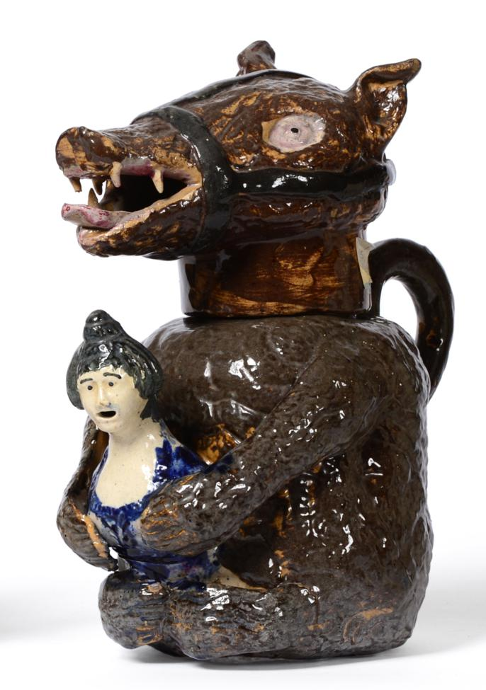 Lot 16 - A Staffordshire Pottery Bear Jug and Cover, early 19th century, the seated animal with brown...