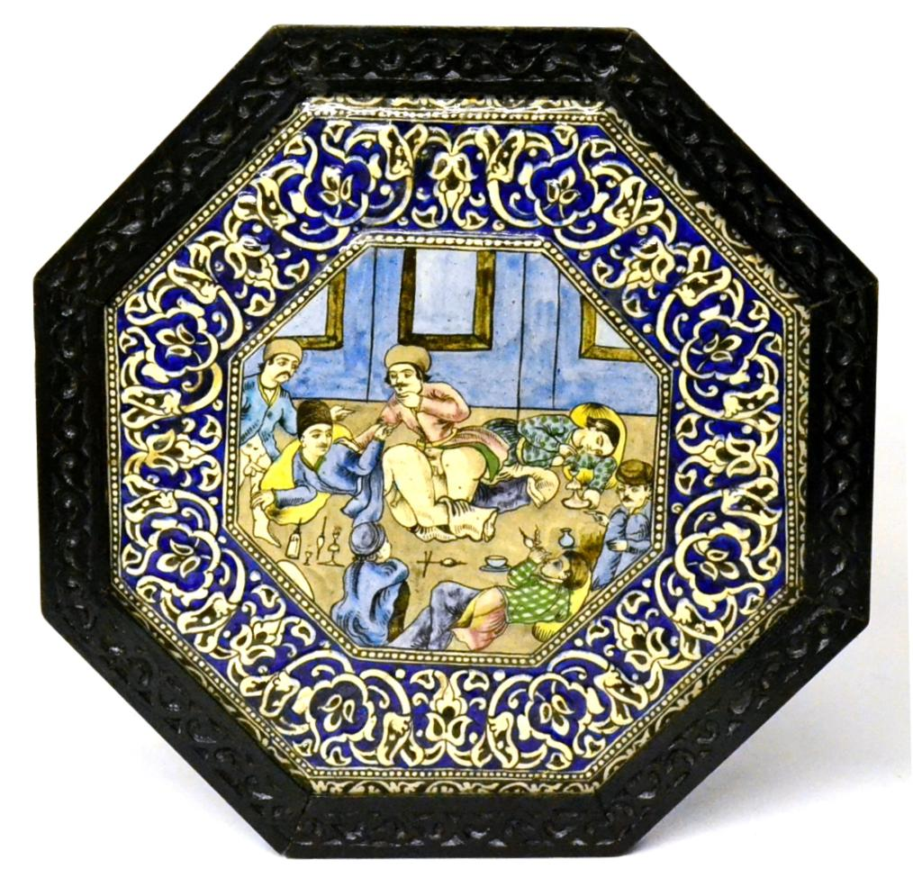 Lot 47 - A Qajar Pottery Octagonal Plaque, early 20th century, the central panel painted with an erotic...