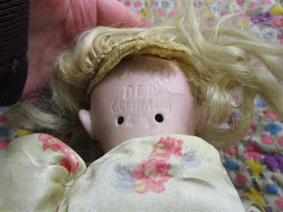 Lot 1015 - German S&H 1249 small bisque socket head doll, with blond hair wearing a floral dress