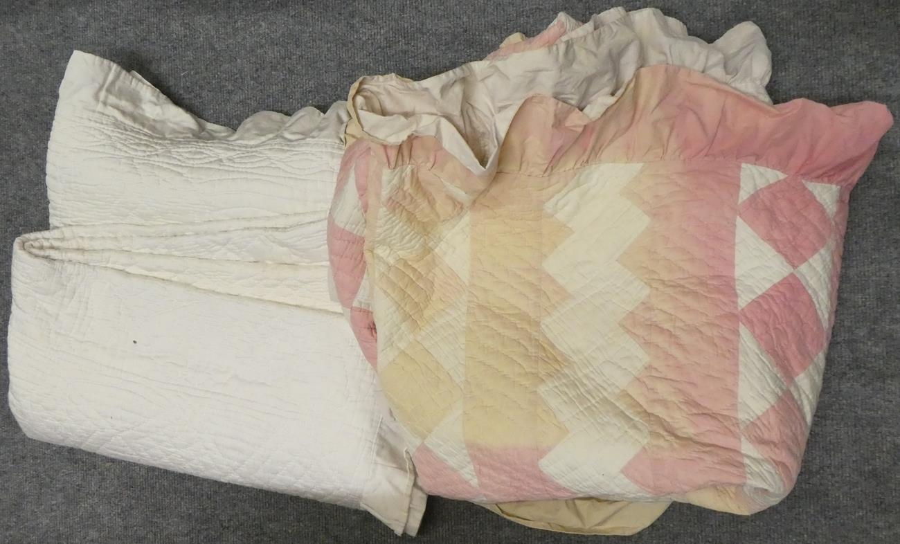 Lot 1041 - Late 19th century cream reversible quilt with pleated frill to the edge, another pink and white...