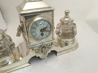 Lot 3037 - A Silver-Plated Inkstand Timepiece, 20th Century, oblong, the base with rests for the two...