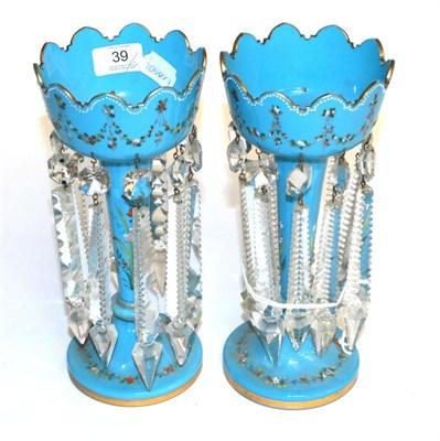 Lot 39 - A pair of enamel decorative blue glass table lustres