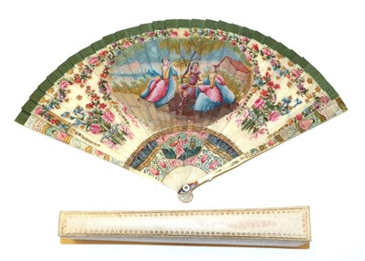 Lot 4010 - An 18th Century Ivory Brisé Fan, ribboned in green silk, the guards and gorge sticks painted...