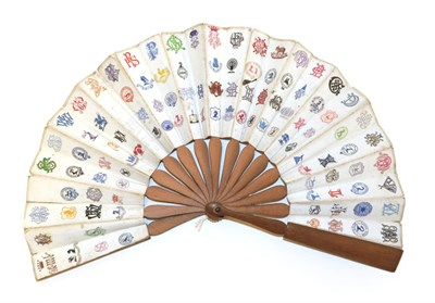 Lot 4033 - A Telescopic Wood Fan, the monture mid brown and unadorned, the double paper leaf decorated...