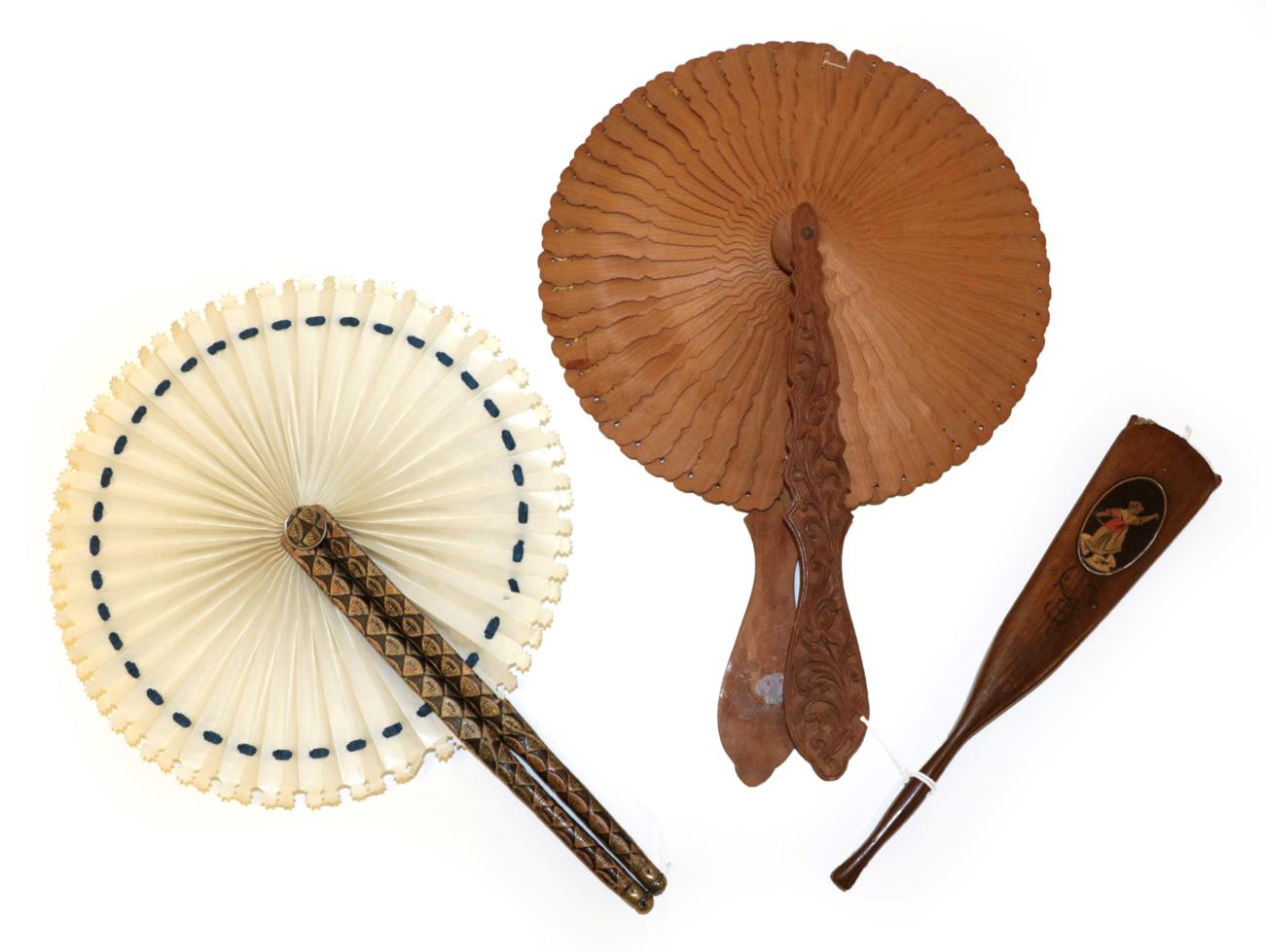 Lot 4036 - A Wood Cockade Fan with elaborately carved and shaped handles, these featuring scrolling...