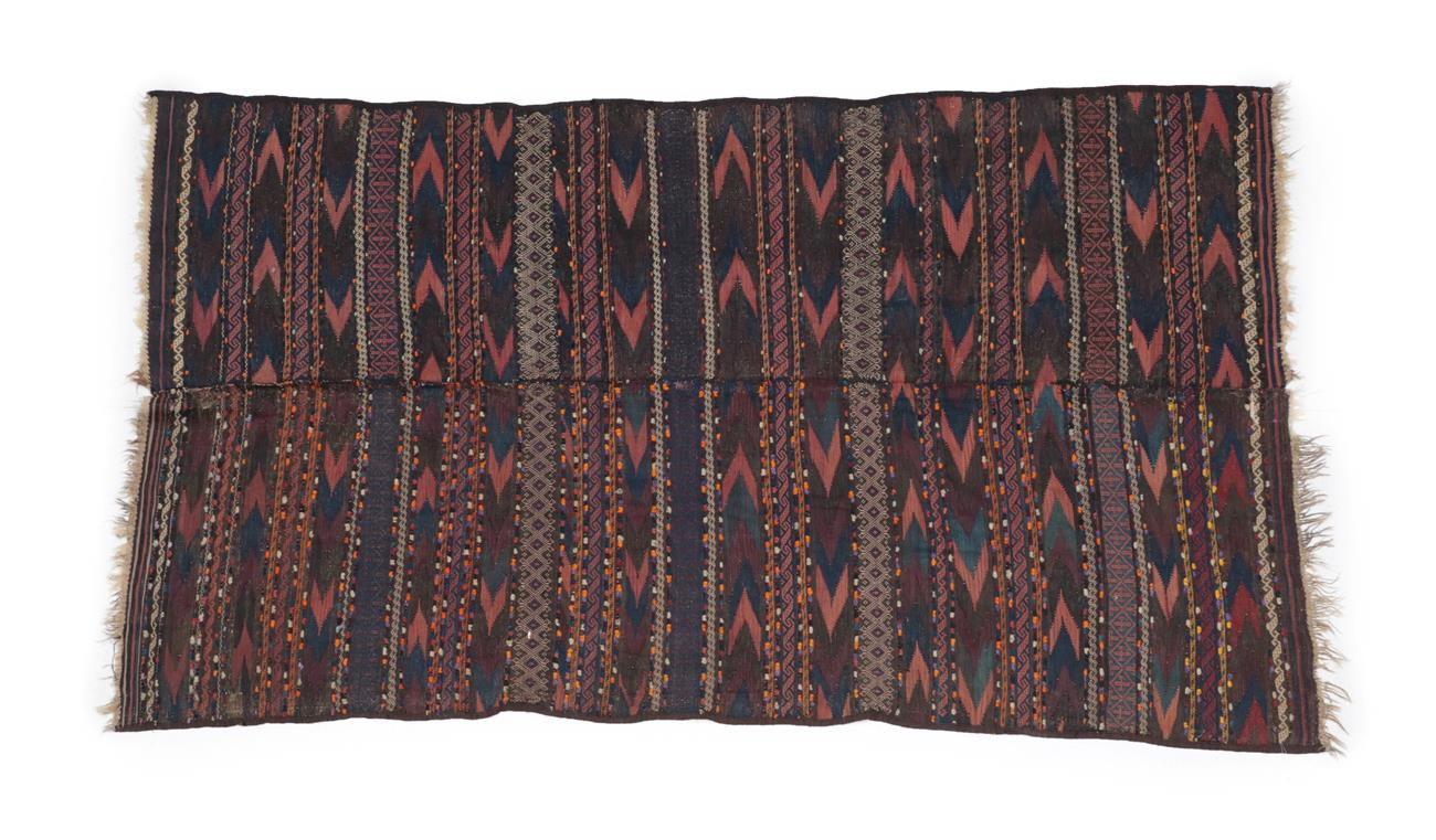 Lot 494 - Balouch Kilim West Afghanistan, 20th century Woven in two panels, the deep polychrome field of...