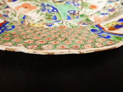 Lot 61 - A Chinese Porcelain Charger, Kangxi, painted in famille verte enamels with foliage within landscape