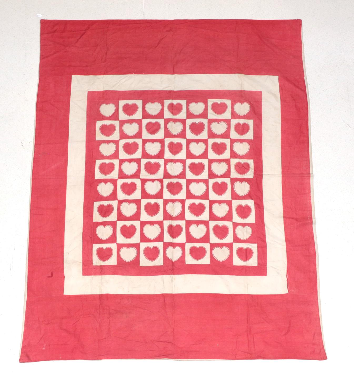 Lot 6019 - A 19th Century Wedding Patchwork Cover, of turkey red and white  hearts, edged with feather...