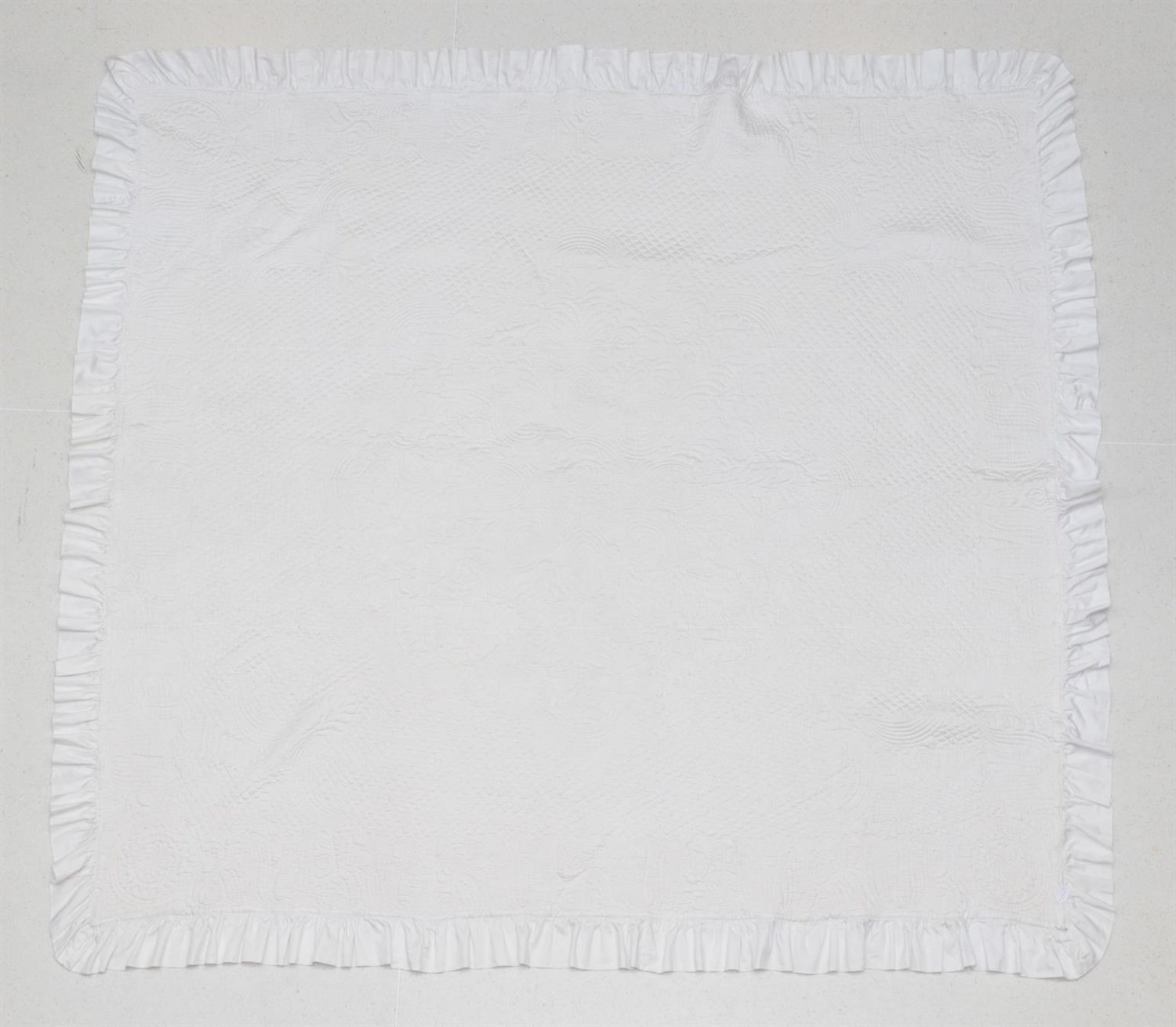 Lot 6030 - Late 19th Century White Cotton Reversible Quilt, finely quilted overall with a central flower head