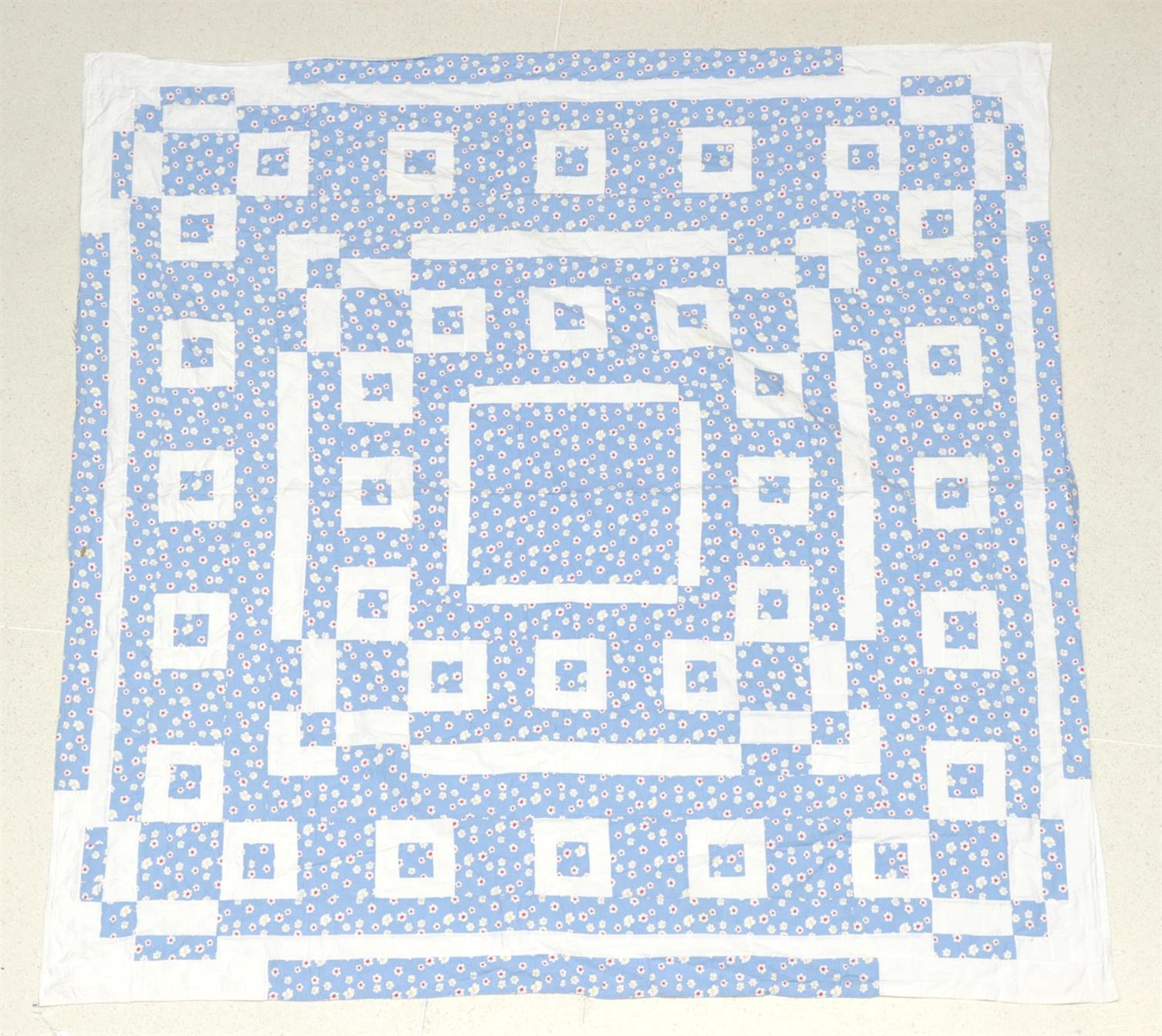Lot 6034 - Early 20th Century Blue Floral Quilted Bed Cover, designed with white cotton squares  and...