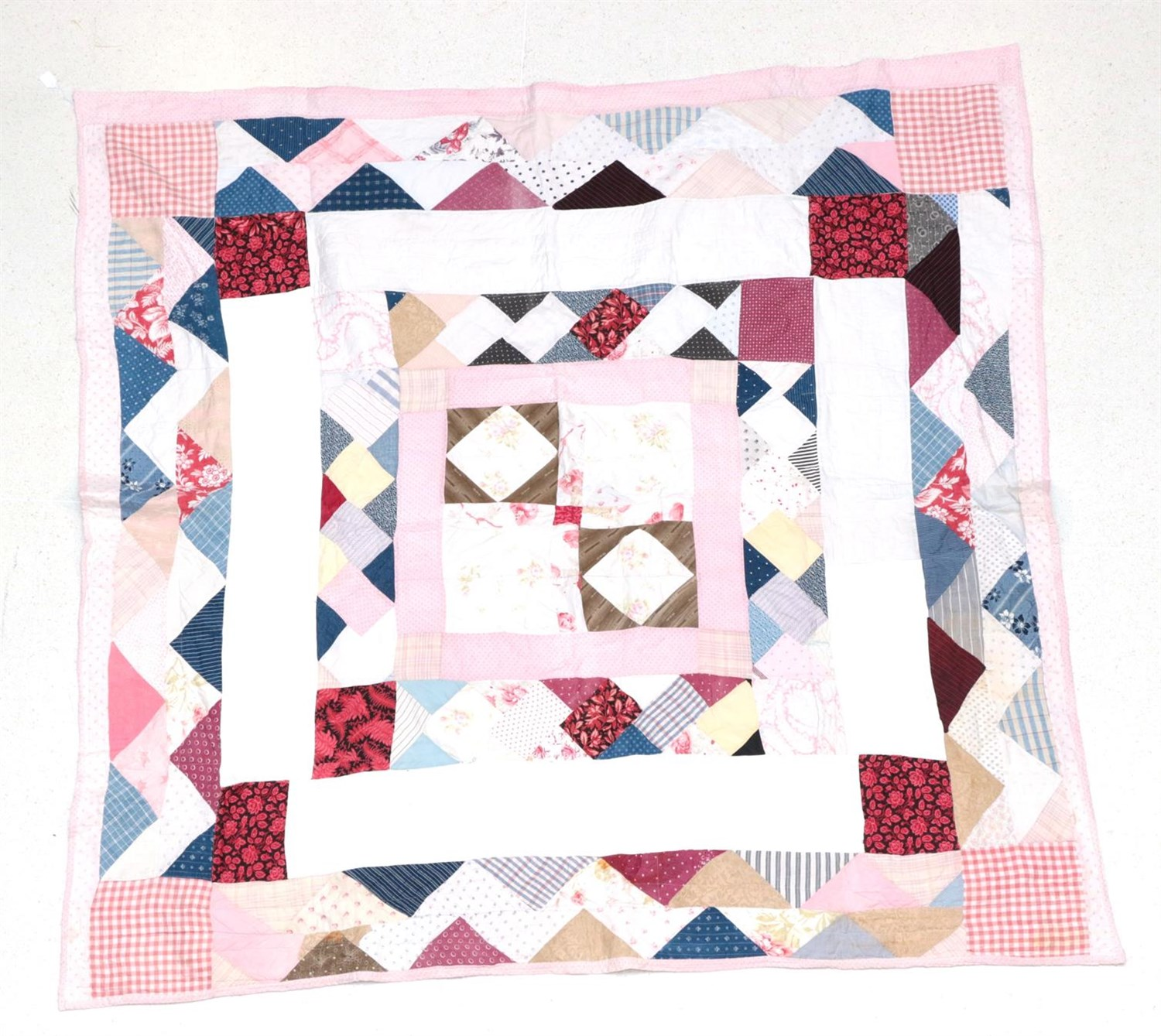 Lot 6035 - Late 19th Century North Country Thrift Quilt, designed in a mosaic pattern with central square,...