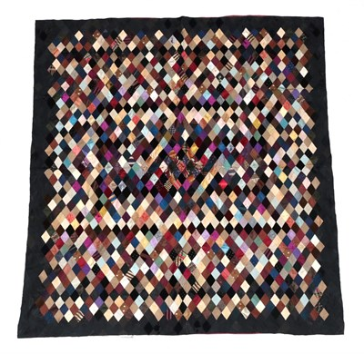 Lot 6037 - Victorian Silk Patchwork, comprising coloured silks in a diamond pattern, central pattern and black